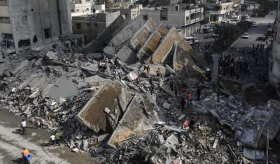 Gaza City, 2014. Palestinians check the remains of Al-Basha, a building that was destroyed by an Israeli air strike.