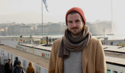 Alexis Comninos, LLM student at the Geneva Academy, in front of the Bains des Pâquis