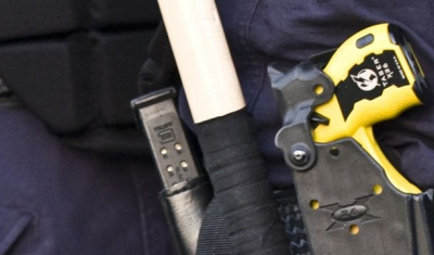 Belt of police officers with a Taser