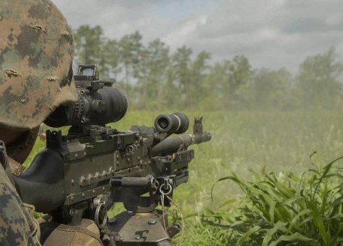 A U.S. Marine fires an M240B machine gun at a target during a company attack exercise at Fort A.P. Hill