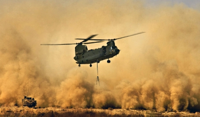 A Royal Air Force CH47 Chinook Helicopter creates a dust storm during the re-supply of the men of 42 Commando Royal Marines at Patrol Base Delhi before Operation Glacier 4 in the Afghan district of Garmsir.