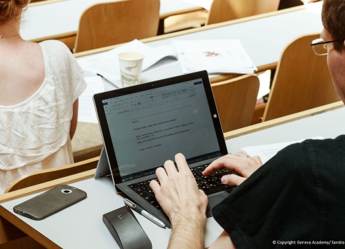 LLM student taking notes during a course on his laptop