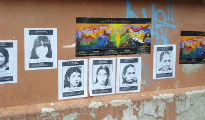 Guatemala, photos of disappeared on a wall