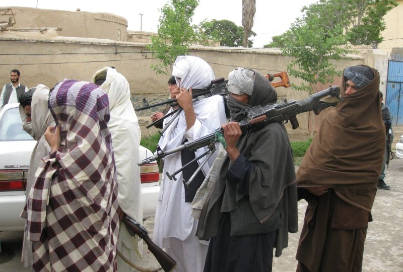 Taliban fighters meet with Government of the Republic of Afghanistan officials in Kandahar City, April 11, 2011, and peacefully surrendered their arms as part of the government's peace and reintegration process.