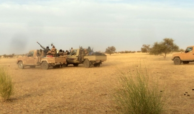 Armed Islamist fighters race near the Mauritania-Mali border