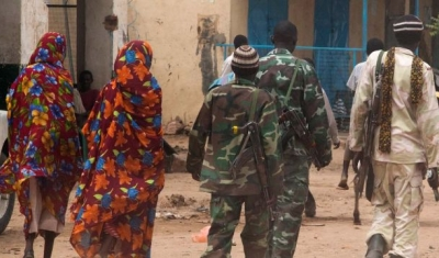 Kutum, North Darfur: Members of the Sudanese army patrol Kutum market