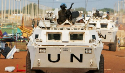 UN Peacekeepers on Patrol in Abyei, Sudan. Zambian peacekeepers from the United Nations Mission in Sudan (UNMIS) patrol streets lined with looted items awaiting collection in Abyei, the main town of the disputed Abyei area on the border of Sudan and newly